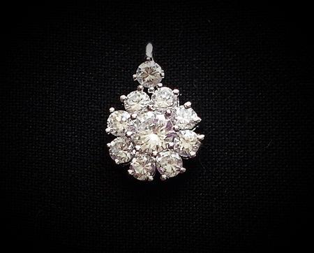 Diamond flower pendant on black background