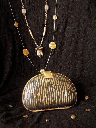 Gold zebra print clutch purse Stock Photo