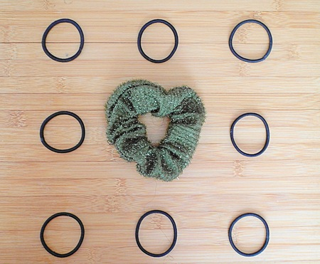 Hair accessories arranged in rows on a wooden surface