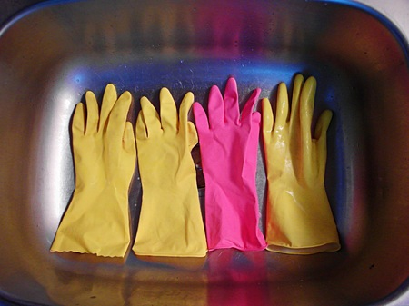 latex: Colorful latex gloves in a stainless steel sink Stock Photo
