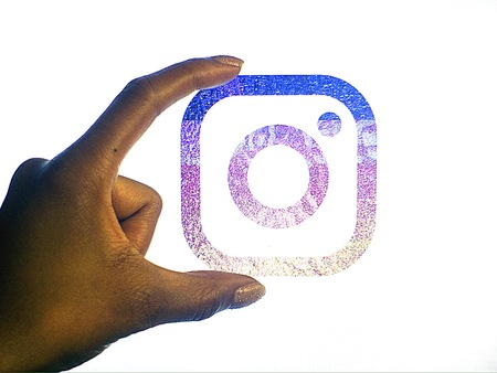 New instagram logo held by a hand on a white background Stock Photo - 59346573