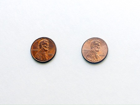 Overhead shot of two pennies on white background