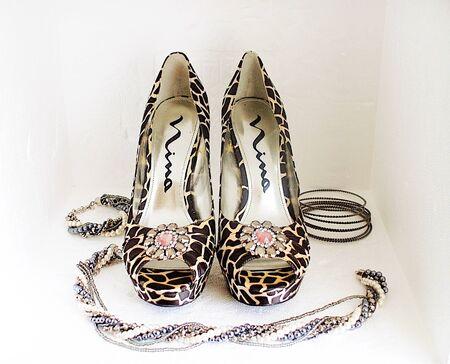 animal print high heels and shiny jewelry