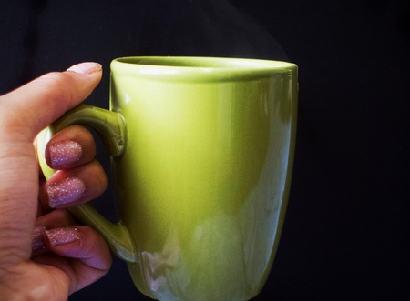 Hand holding a hot beverage