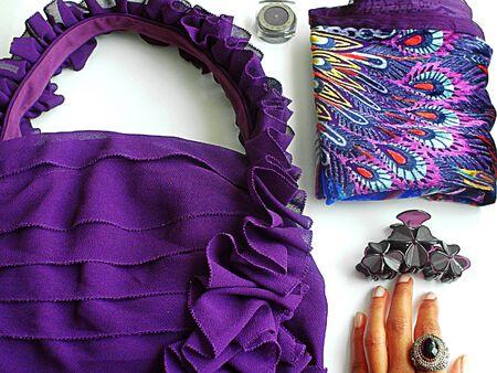 Purple flat lay fashion items.