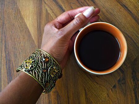 Holding a hot cup of tea Stok Fotoğraf