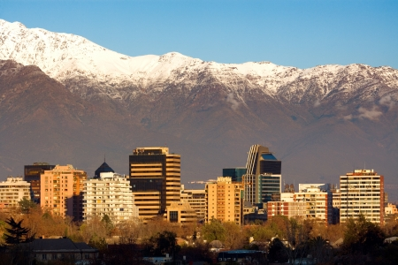the mountain range: Skyline of Providencia district in Santiago de Chile with snowed Andes mountain range in the background.  This is a wealthy residential and commercial district in the city.