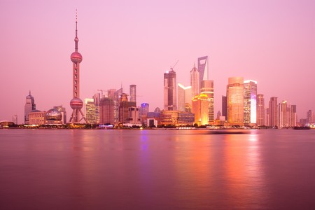 Skyline of Lujiazui and Pudong with the Oriental Pearl Tower, Jiinmao Tower and Shanghai World Financial Center (SWFC), across the Huangpu river, Shanghai, China, Asia