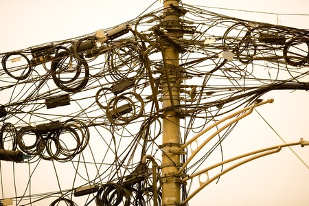 A tangle of cables and wires in Shanghai, China Archivio Fotografico