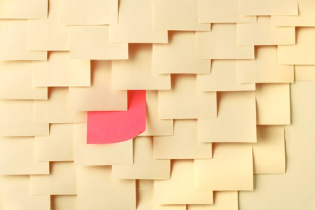Arrange Postit notes with one of a different color photo