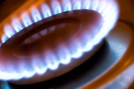Gas flame on a kitchen hob photo