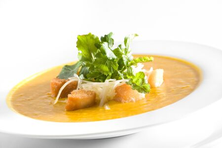 Pumpkin soup with croutons and parmesan cheese