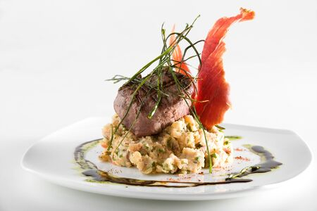 Gourmet piece of meat over a bed of mashed potatoes  Archivio Fotografico