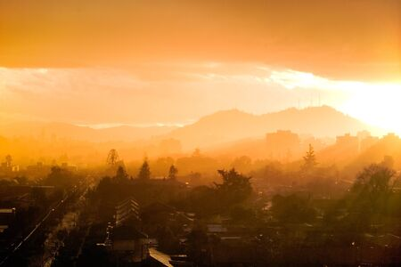 Sunrays on a stormy day over Santiago, Chile photo