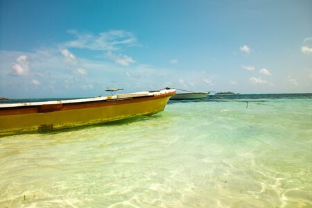 Fishing boats anchored in the main beach of San Andres Island, Colombia Stock Photo