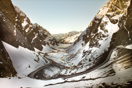 distant work: Road to Andina copper mine in chilean Andes Stock Photo