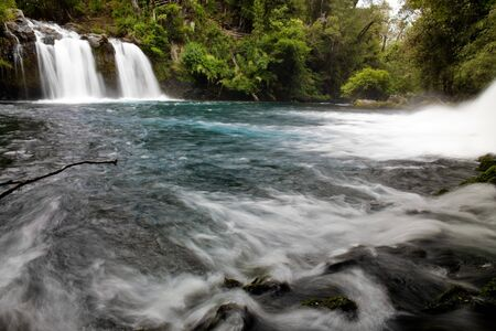 Waterfall named Ojos del Carburga, Araucania district, Southern Chile Stock Photo