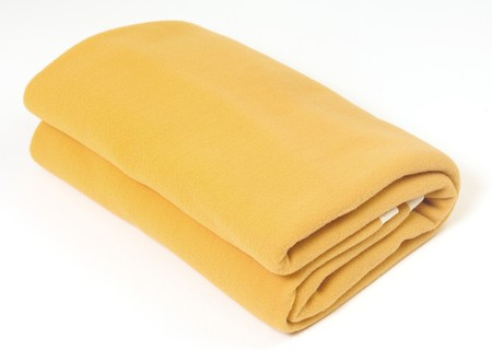 Yellow blanket against a white background