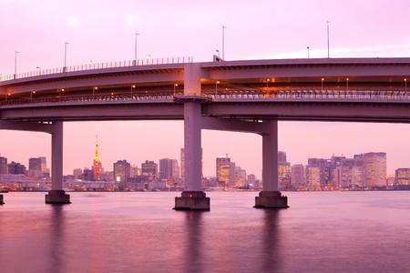 honshu: Access to Rainbow Bridge and city skyline with Tokyo Tower, Odaiba, Tokyo, Kanto Region, Honshu, Japan Stock Photo