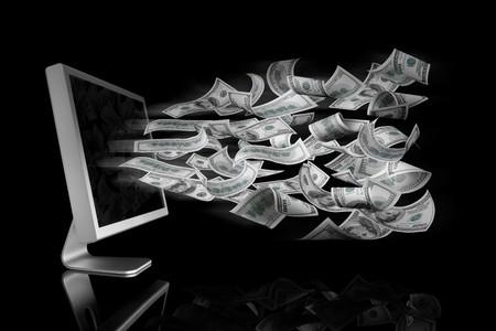 adentro y afuera: 100 Billetes de d�lares saliendo de una pantalla de ordenador  Foto de archivo