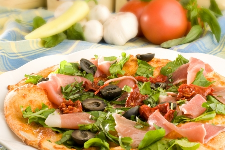 Pizza with ham, olives and capsicum pepper  Stock Photo