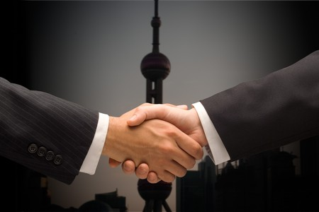 Hands shaking closing a buisiness deal