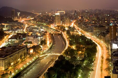 Night view of santiago de Chile toward the east part of the city, showing the Mapocho river and Providencia and Las Condes districts
