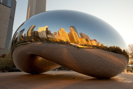 Michigan Avenue skyline reflected on Cloud Gate, a public sculpture created by artist Anish Kapoor.   AT&T plaza at Millenium park, Chicago, Illinois, USA