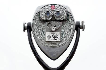 Coin operated binoculars on white photo