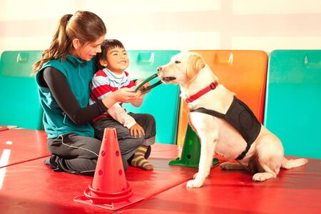 trained: Patient being treated with the assistance of a trained dog