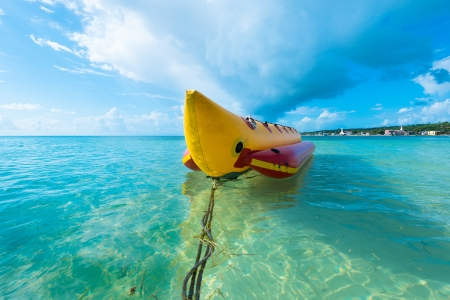 yellow boats: Inflatable banana boat at Caribbean Sea, San Andres Island, Colombia, South America