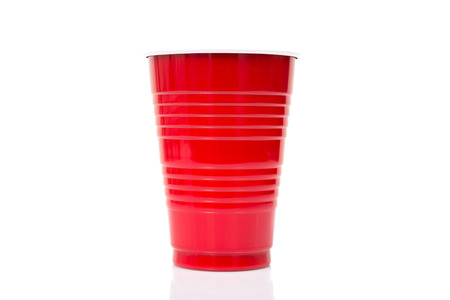 disposable cup: Red Plastic cup isolated against a white background