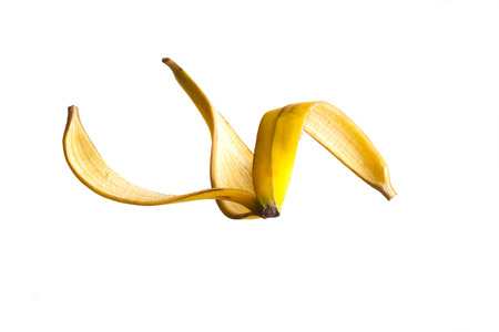 pitfall: Banana peel floating on air against a white Background Stock Photo