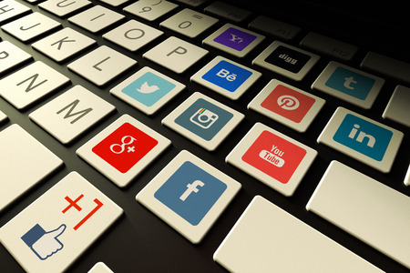 Santiago, Chile - October 16, 2014:  The most popular and visited social media web sites on 2014 represented with the logos embedded in a keyboard.