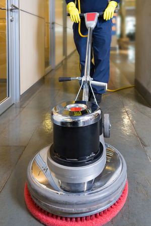 cleaning an office: Industrial buffing machine polishing the floor in a hallway