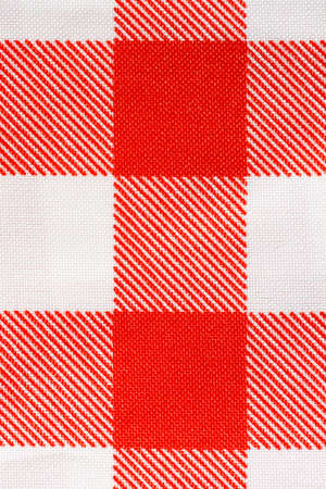 checked fabric: A macro close up of a tablecloth checked fabric background Stock Photo