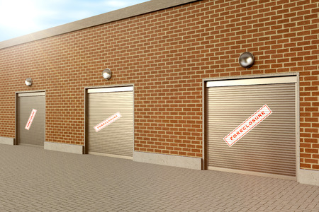 foreclosed: Closed roller doors at business with foreclosure sign Stock Photo