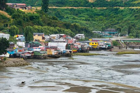 pile dwelling: Traditional stilts houses known as Palafitos in Castro, Chiloe Island, Chile Stock Photo