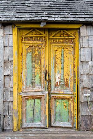 barn door: Old damaged door in Castro, Chiloe Island, Chile