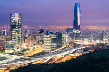 illuminating: Skyline of Santiago de Chile with modern office buildings at financial district in Las Condes.