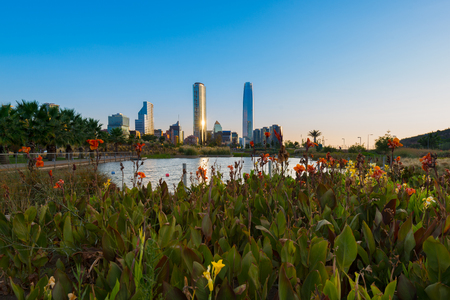 Pond at Bicentennial Park in the wealthy Vitacura district and skyline of buildings at financial district, Santiago de Chile Stock Photo