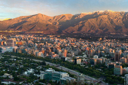Santiago, Region Metropolitana, Chile - December 26, 2016: View of buildings at Providencia district, the most dense part of the city with residential and office buildings and Los Andes mountain range as background. Editorial
