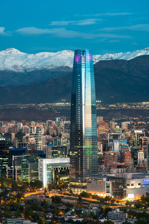 Santiago, Region Metropolitana, Chile - December 26, 2016: View Gran Torre Santiago, the tallest building in Latin America, a 64-story tall skyscraper with a view of ski centers in the back on The Andes mountains. Editorial