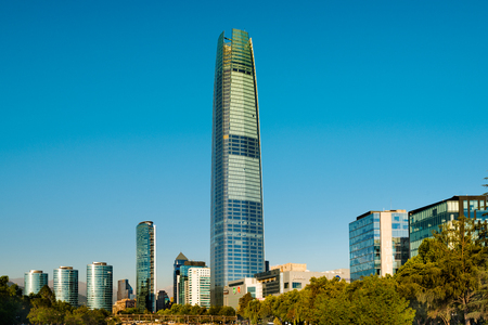 Santiago, Region Metropolitana, Chile - December 27, 2016: Skyline of the financial district in Santiago popularly know as Sanhattan, with Costanera Center main building the tallest skyscraper in South America. Редакционное