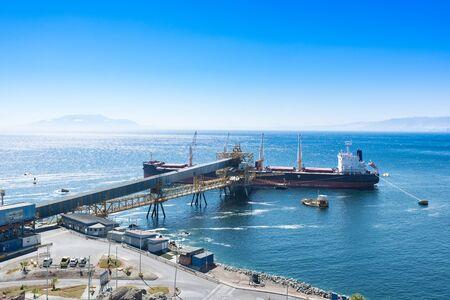 unloading: Antofagasta, Antofagasta Region, Chile - April 19, 2017: Cargo ship docked at Puerto Coloso, an alternative port from the port of Antofagasta, serving mining shipments from Escondida Mine.