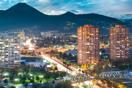 Elevated view of Las Condes district in Santiago de Chile and Manquehue Avenue with Manquehue hill in the back Stock Photo