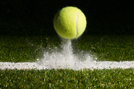 Match point with a tennis ball hitting the line Stock Photo