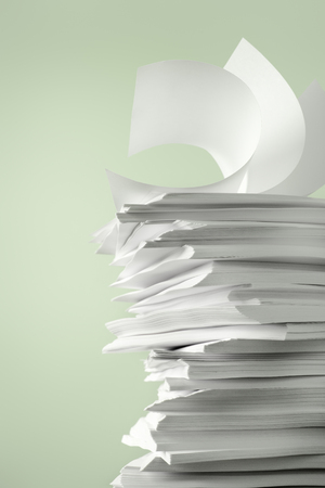 Stack of Papers against a plain color background Archivio Fotografico - 95058275