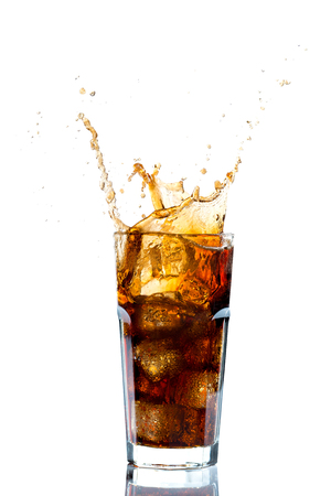 Ice splashing on a glass of a Cola drink against a white background Фото со стока - 96322136