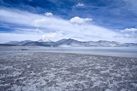 Salar de Aguas Calientes (Spanish for Hot Waters Salt Lake) and lagoon in the Altiplano (high Andean plateau) over 4000 meters over the sea level, Los Flamencos National Reserve, Atacama desert, Antofagasta Region, Chile, South America